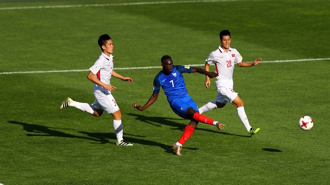 France progress with 4-0 win over Việt Nam