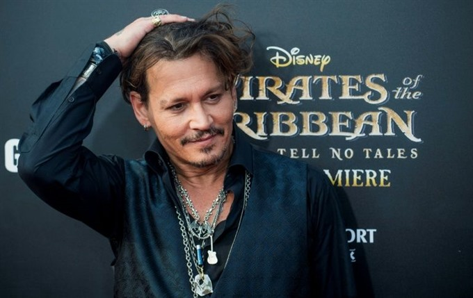 US filmgoers keep eye on Sparrow as Pirates opens strong
