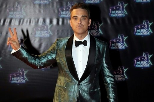 Robbie Williams and Black Eyed Peas join Manchester benefit gig