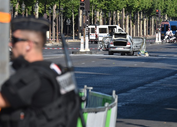 Car ploughs into police van in Paris Champs-Elysees attack