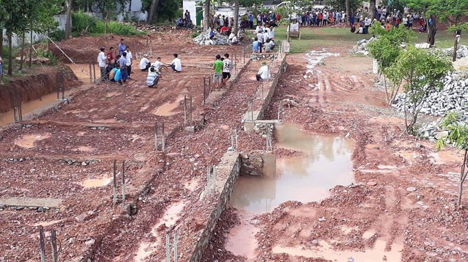 Two children drown in manmade pit after storm