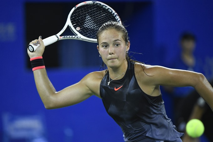 Halep and Wozniacki out at Wuhan Open Muguruza sails through