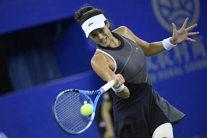 World No 1 Muguruza powers into Wuhan quarters
