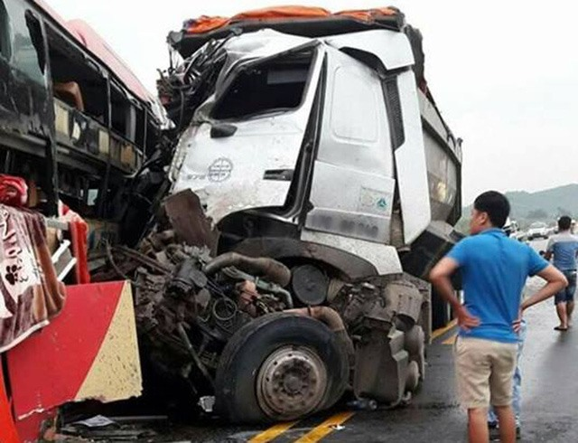 16 injured in head-on collision between truck bus