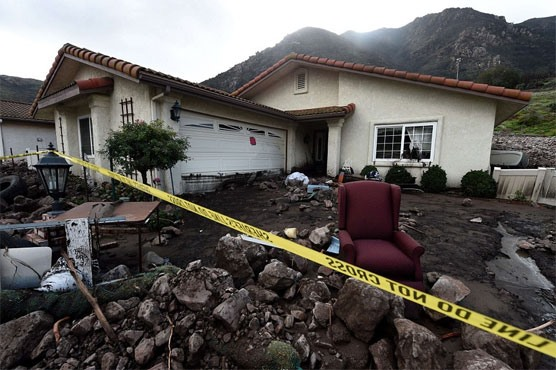 California mudslides demolish homes killing at least 13
