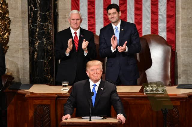 Trump calls for unity after tumultuous first year