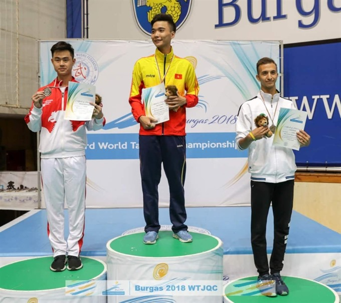 Kiên wins gold at world wushu taijiquan champs