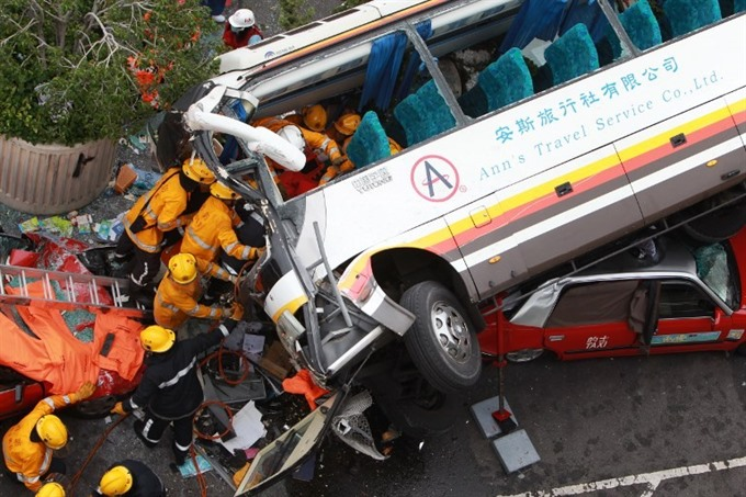 Five dead 32 injured in Hong Kong coach crash: police