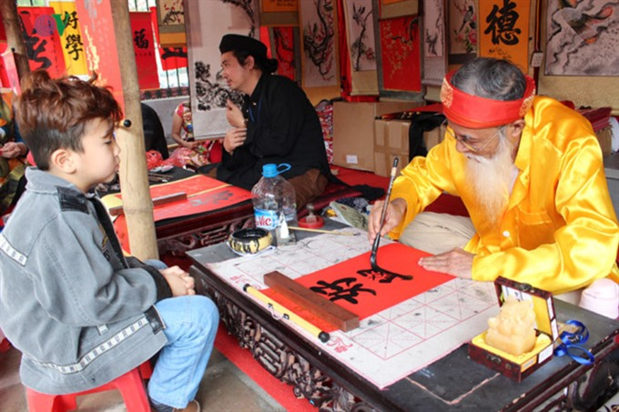 Tết event celebrates folk art calligraphy