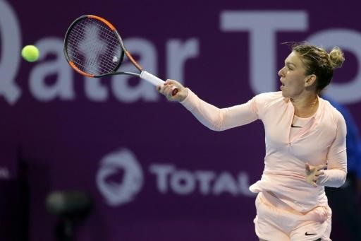 Halep makes Qatar quarters despite ankle worry