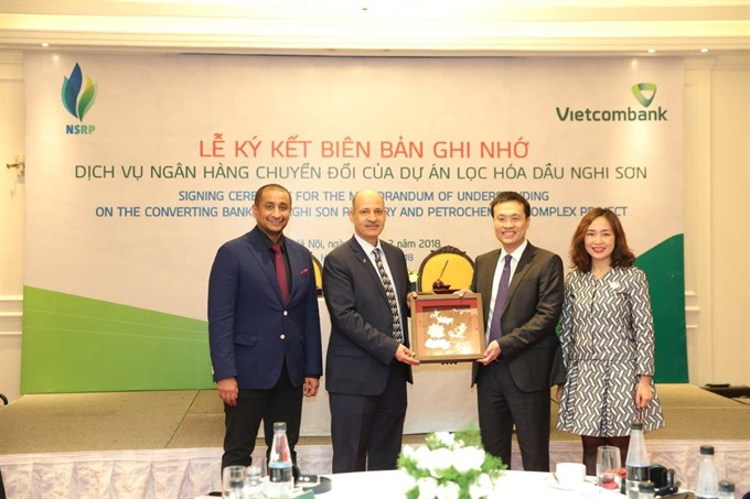 Vietcombank sign agreement to provide converting bank service