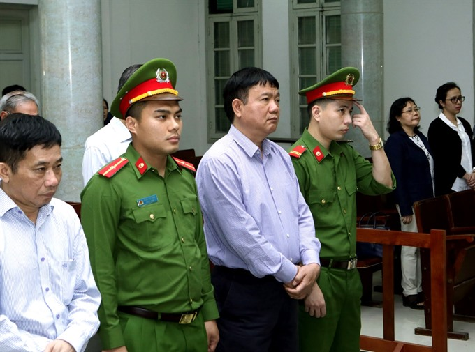 Đinh La Thăng gets 18 year asked to compensate in 34.8 USmillion loss case