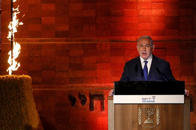 Dont test Israels resolve PM warns Iran on Holocaust Day