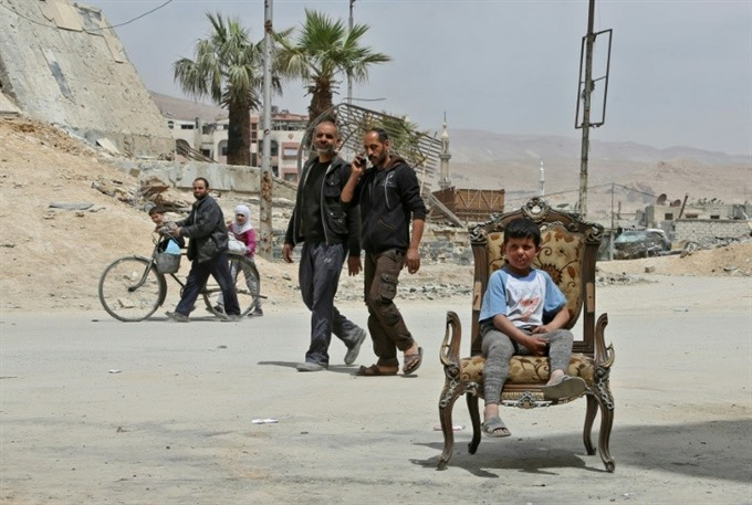 Chemical inspectors await all-clear to begin work in Syrias Douma