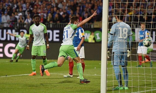 Wolfsburg beat Holstein Kiel to stay in Bundesliga