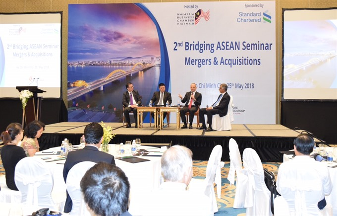 Huge opportunities in VN for business acquisitions: seminar
