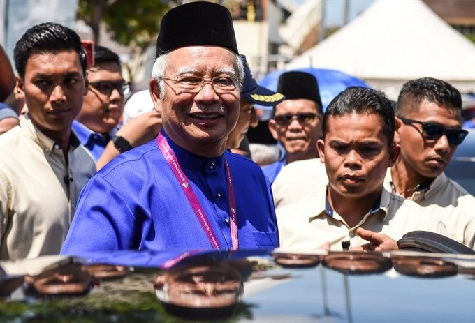 Malaysias scandal-hit PM faces ex-mentor 92 in election