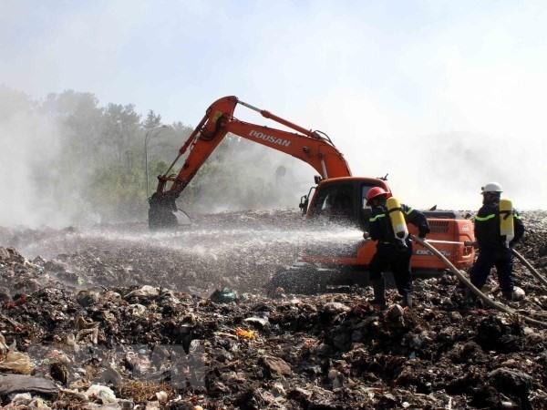 Dozens in hospital after waste dump fire