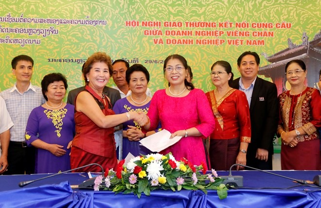 Vientiane conference links VN Lao firms