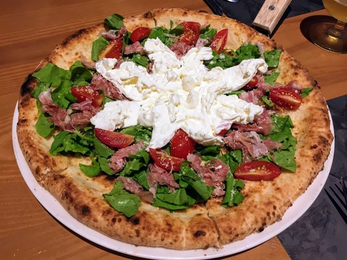 Japanese fusion pizza wins diners hearts