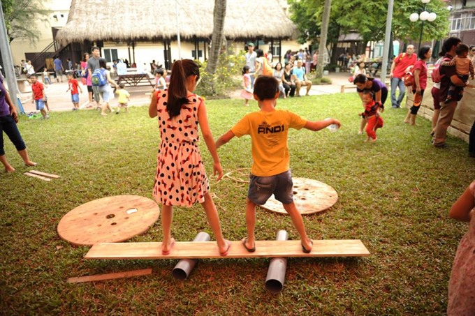 Tires wood and water pipes help children learn through play