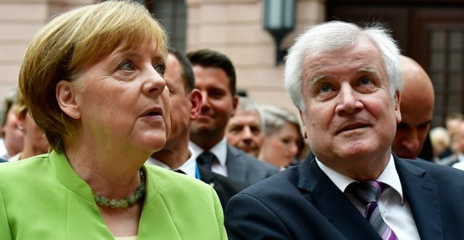 Future of Merkel coalition in doubt as interior minister offers to resign