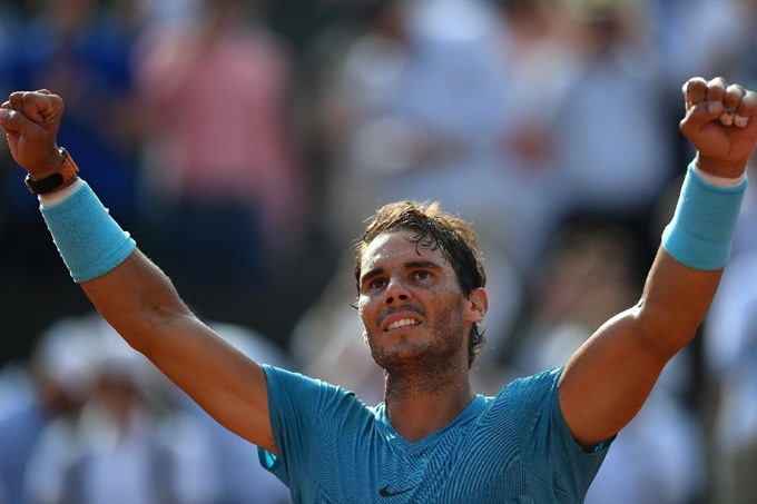 Nadal kills curse of 100 club at Wimbledon