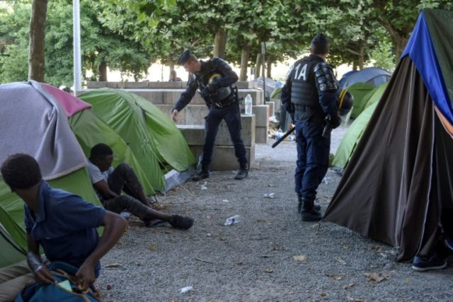 France adopts law on asylum immigration
