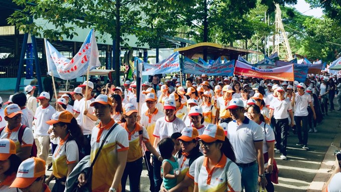 Red Cross holds fundraising walk for AO victims