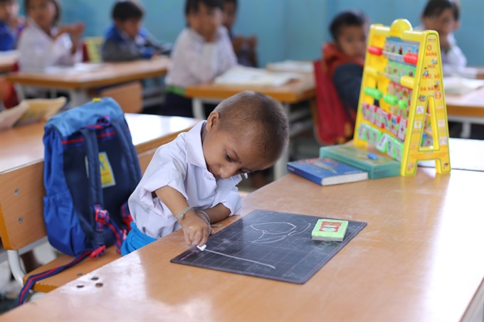 The journey of Việt Nams smallest student