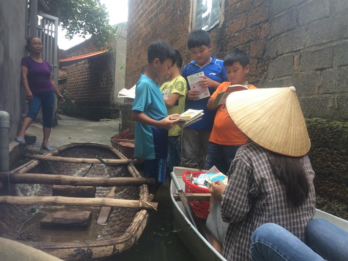 Library fights flood to deliver books by boat