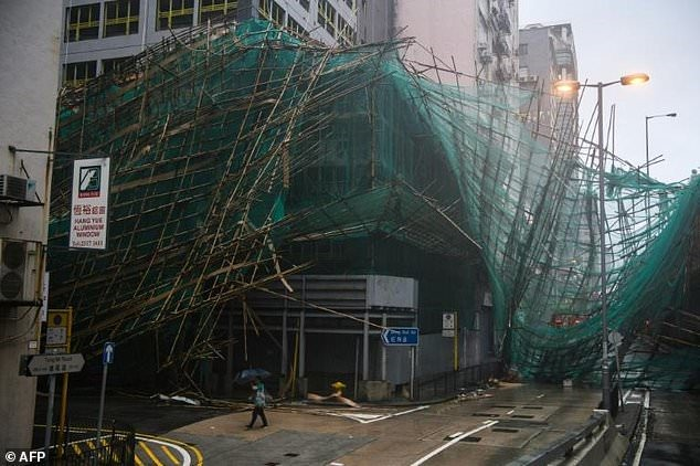 Massive clean-up in Hong Kong after typhoon brings trail of destruction