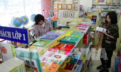 Four publishers licensed to compile textbooks