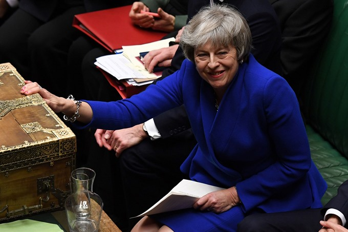 UK PM May reaches out to rivals after winning confidence vote