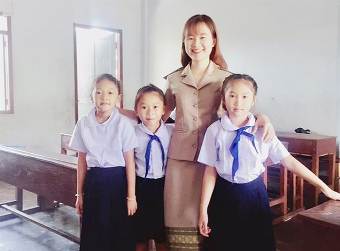 Vietnamese teacher spreads the word in Laos