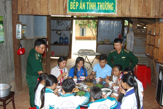 Border guard soldiers help teach students