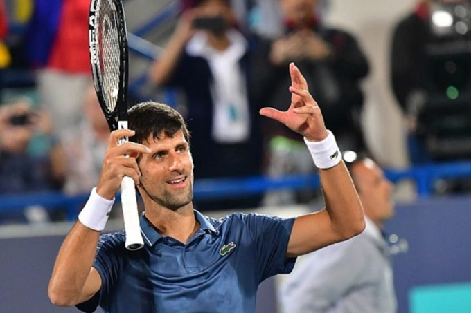 Djokovic battles through to Qatar semi-finals