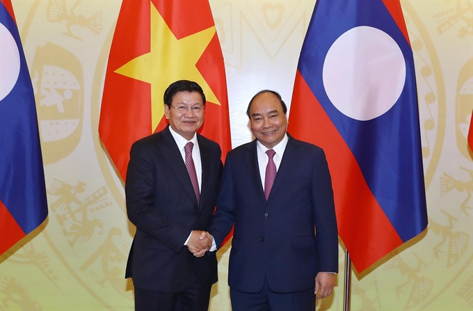 Vietnamese Lao PMs co-chair meeting of inter-government committee