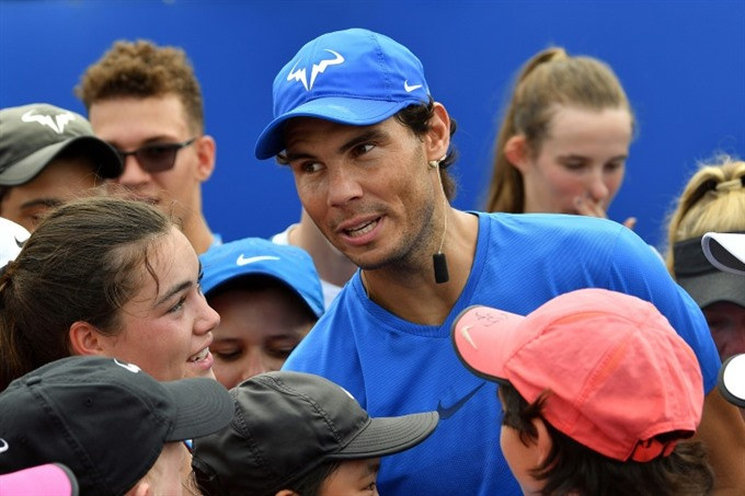 Nadal says no pain after Sydney tie as Slam looms