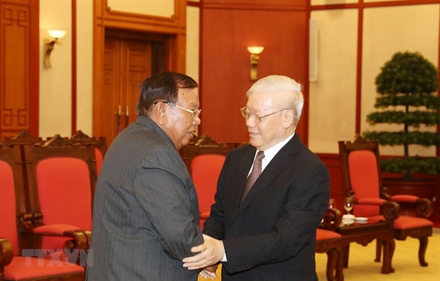 Party leader President meets Lao counterpart