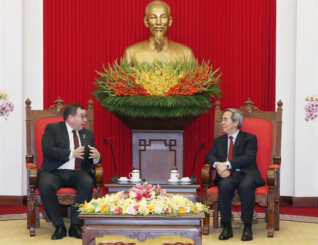 Party official receives New Zealand finance minister