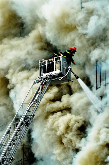 Photo exhibition shows dedication of firefighters