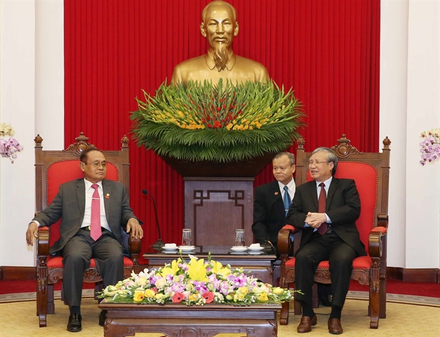 Party official receives Cambodian guest