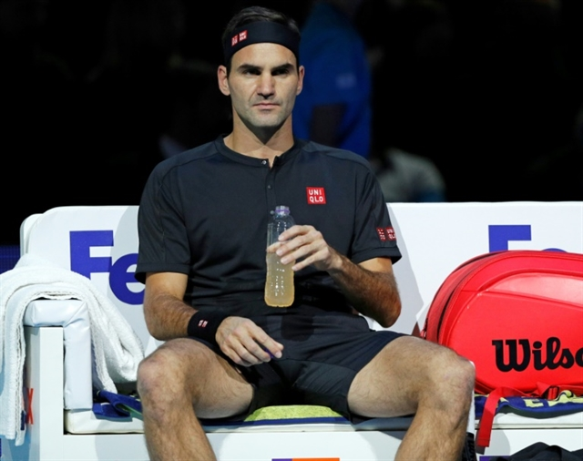 Federer faces early ATP Finals exit after Thiem defeat Djokovic cruises