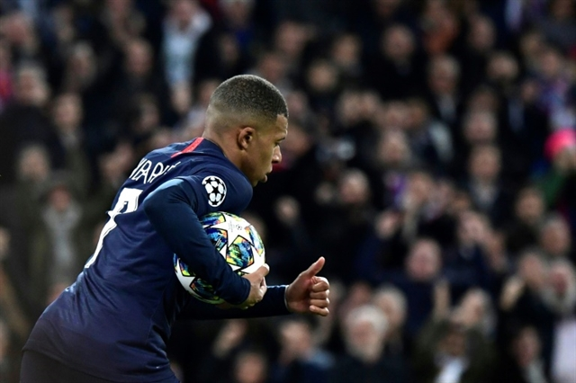 Mbappe stars as PSG snatch dramatic point at Real Madrid