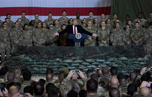 Trump visits troops in Afghanistan says Taliban talks back on