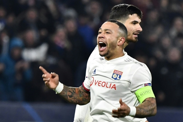 Lyon players fans clash after Depay secures last 16 spot