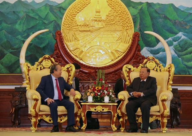 Deputy PM Trương Hòa Bình meets with Lao leaders