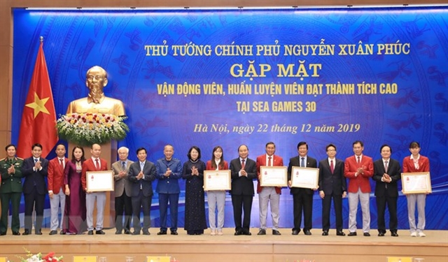 PM Phúc honours athletes coaches in Hà Nội meeting