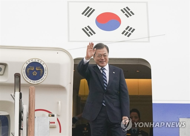 Moon leaves for China to meet Xi Abe and join trilateral summit